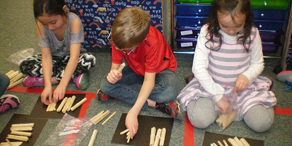 Students combining bundles and sticks